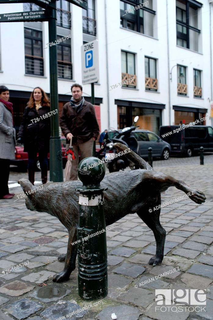 Stock Photo: Dog pissing statue in Brussels, Belgium.