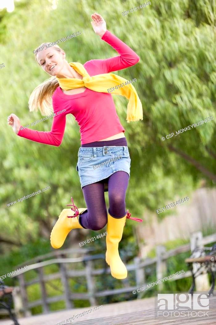 Stock Photo: Teenage Girl Frolicking Outdoors.