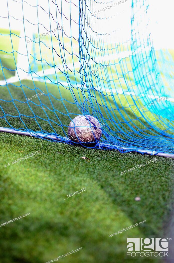 Stock Photo: Soccer ball into a goal in soccer 11.