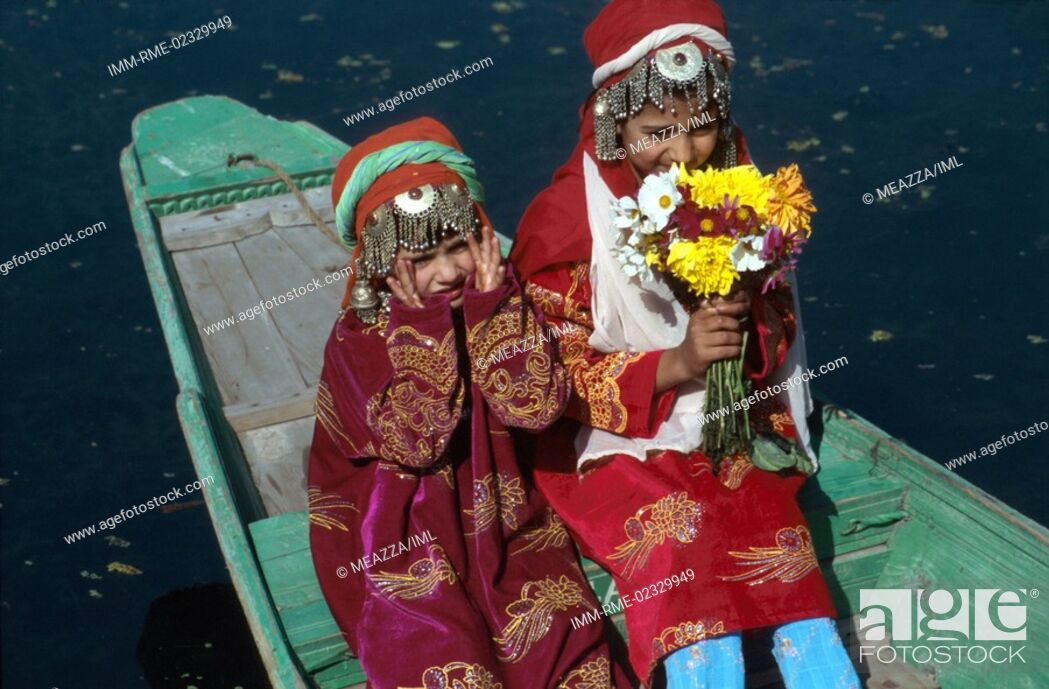 Stock Photo: Srinagar - Dal lake, girls on Shikara Kashmir, India, Asia.
