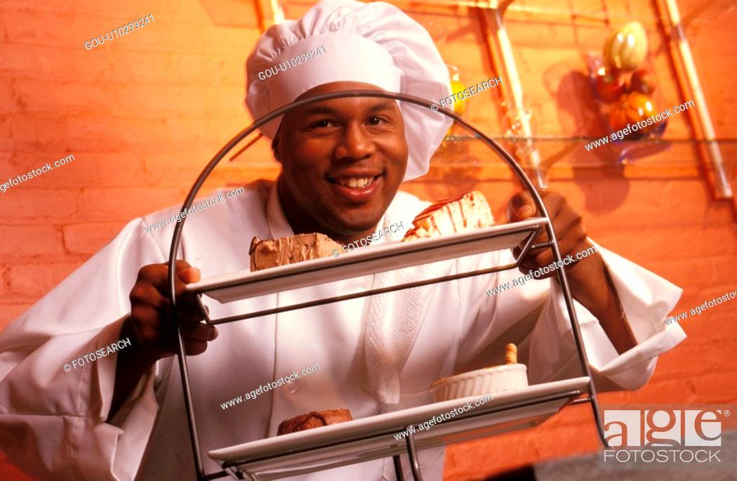 Stock Photo: Chef Holding Dessert Tray.