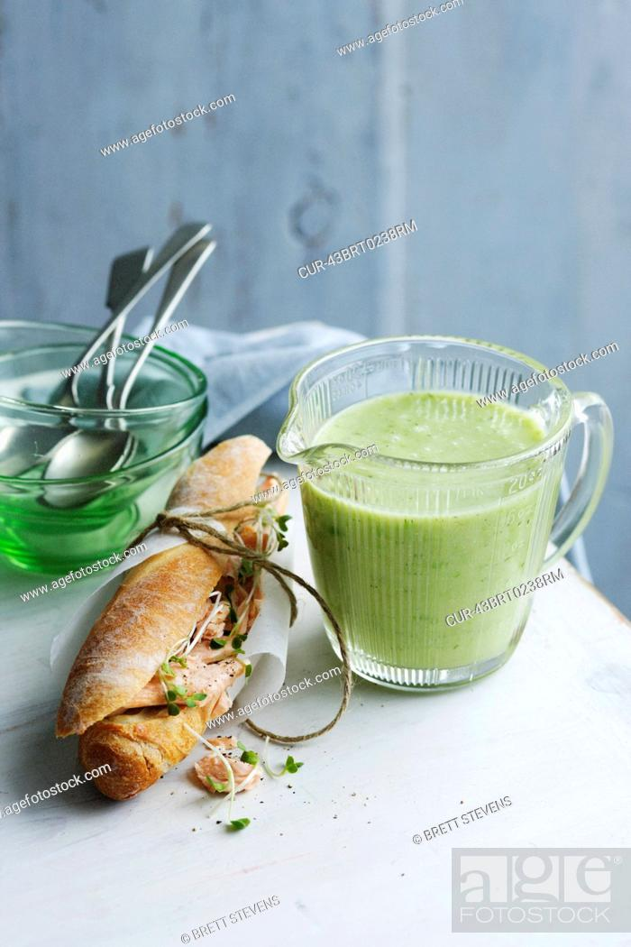 Stock Photo: Jug of cucumber trout soup with sandwich.