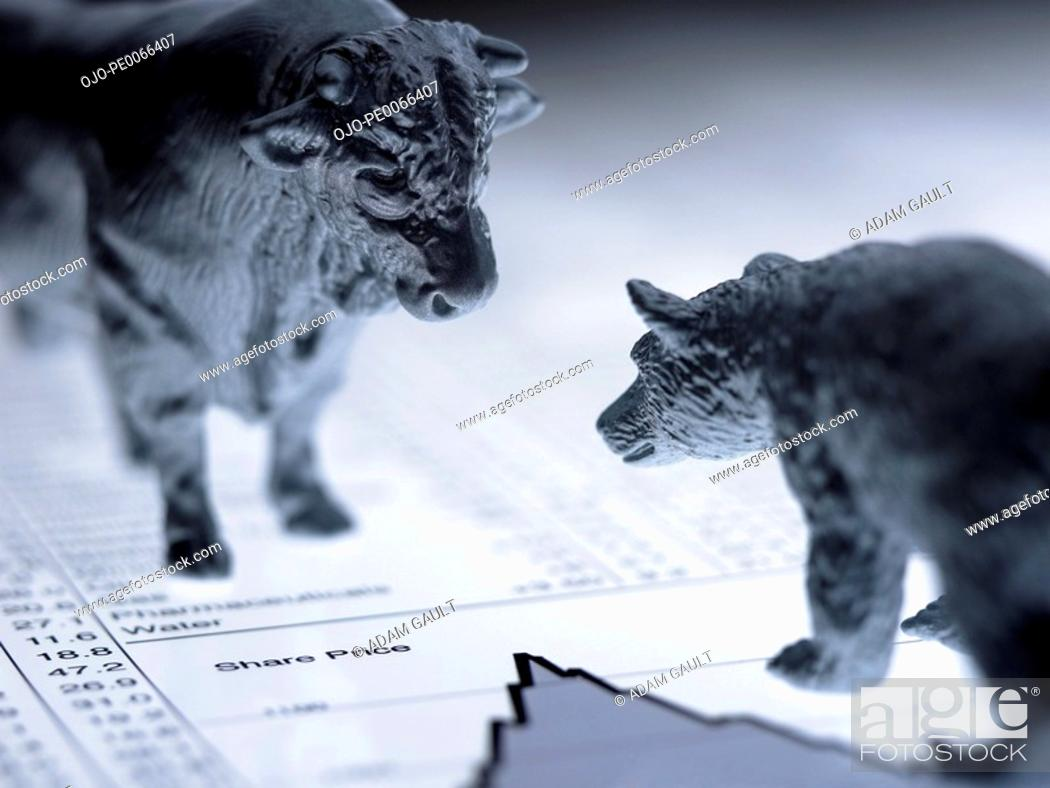 Stock Photo: Bull and bear figurines on list of share prices.