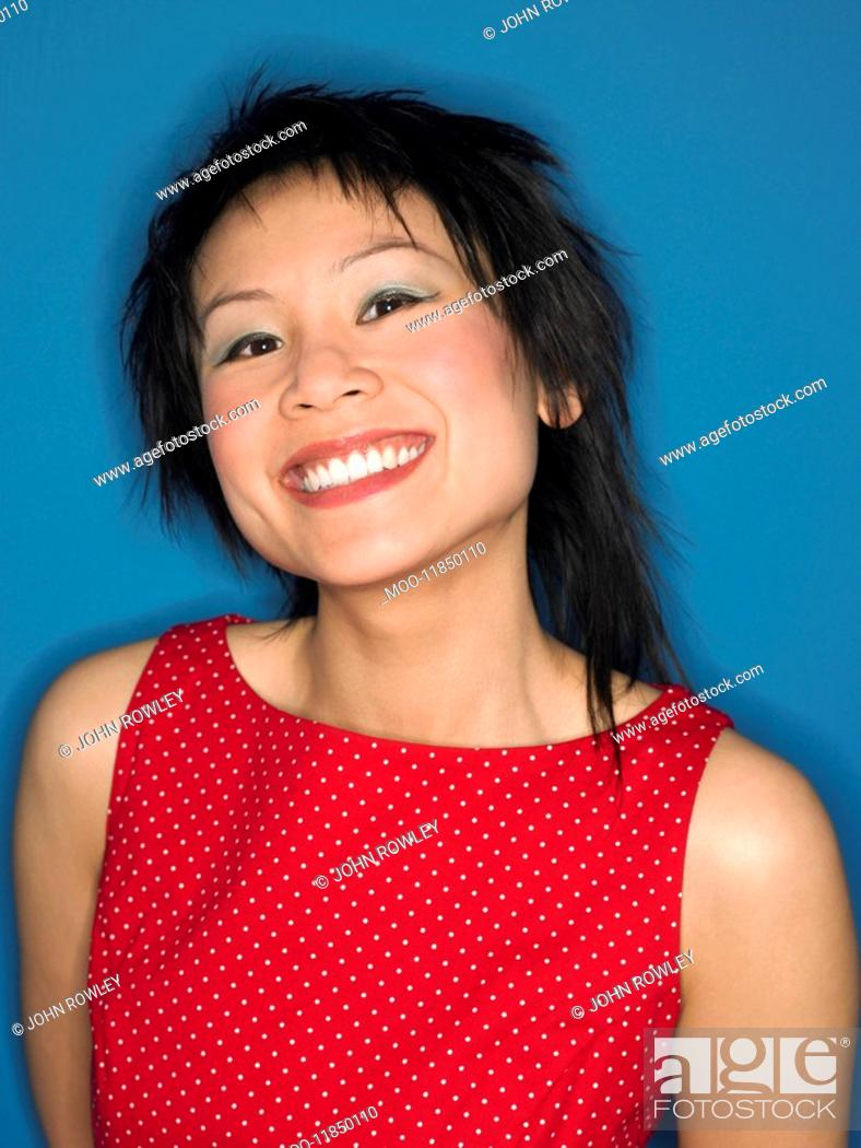 Stock Photo: Woman grinning in studio head and shoulders.