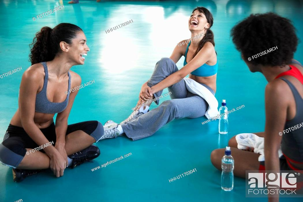 Stock Photo: Young women in sports clothing laughing.