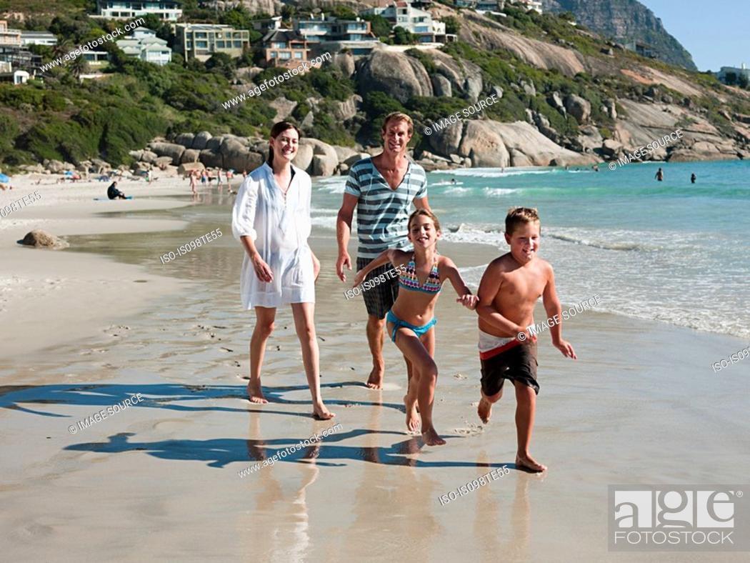Stock Photo: Family on a beach.