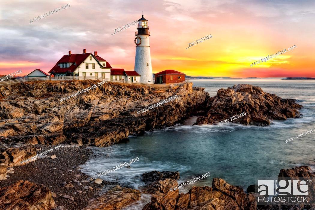 Stock Photo: Portland Lighthouse Sunrise - The sun rises in Portland Head Lighthouse in Portland, Maine.