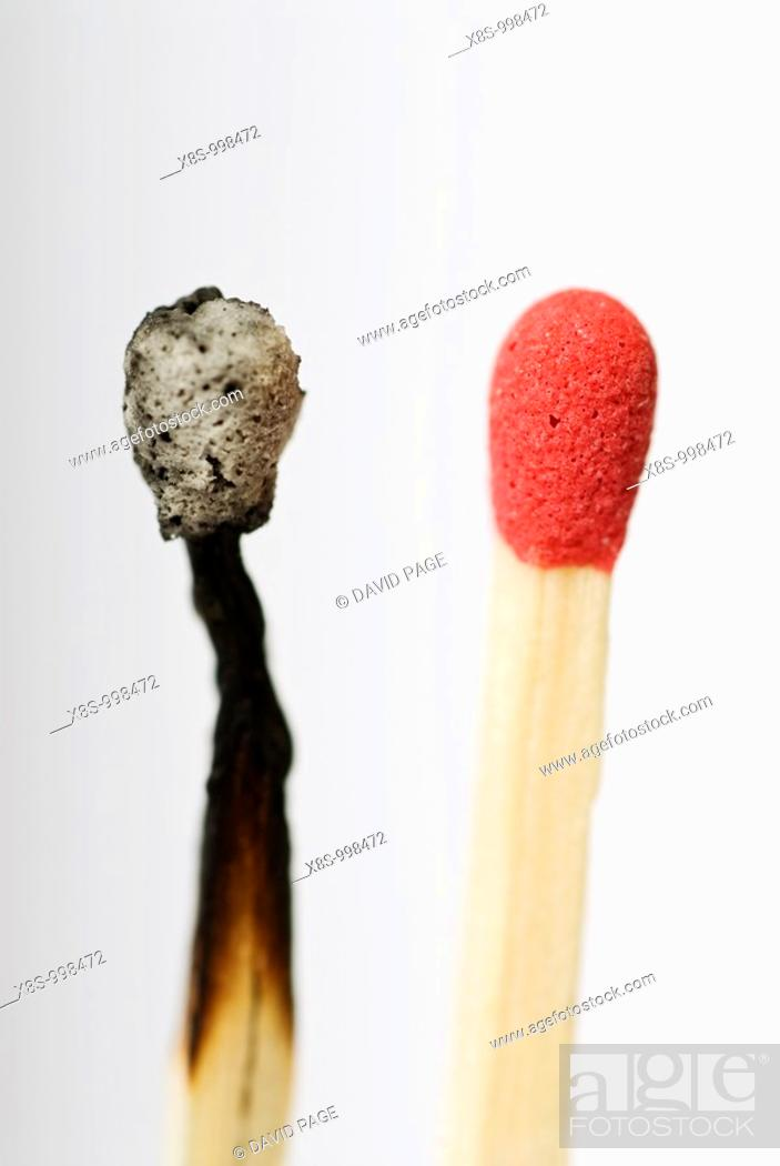 Stock Photo: Stock photo of a live red match head next to an old burnt out match head  Conceptual image to illustrate before, after - old, new - change, dare to be different.