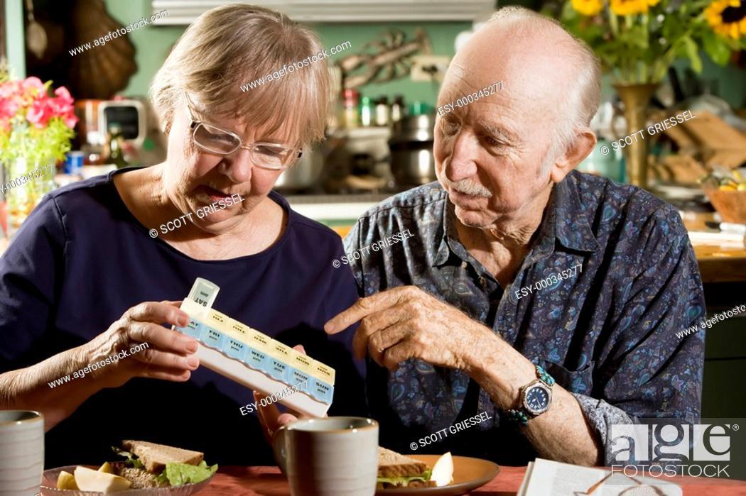 Stock Photo: Portrait of Senior Couple with Pill Case.