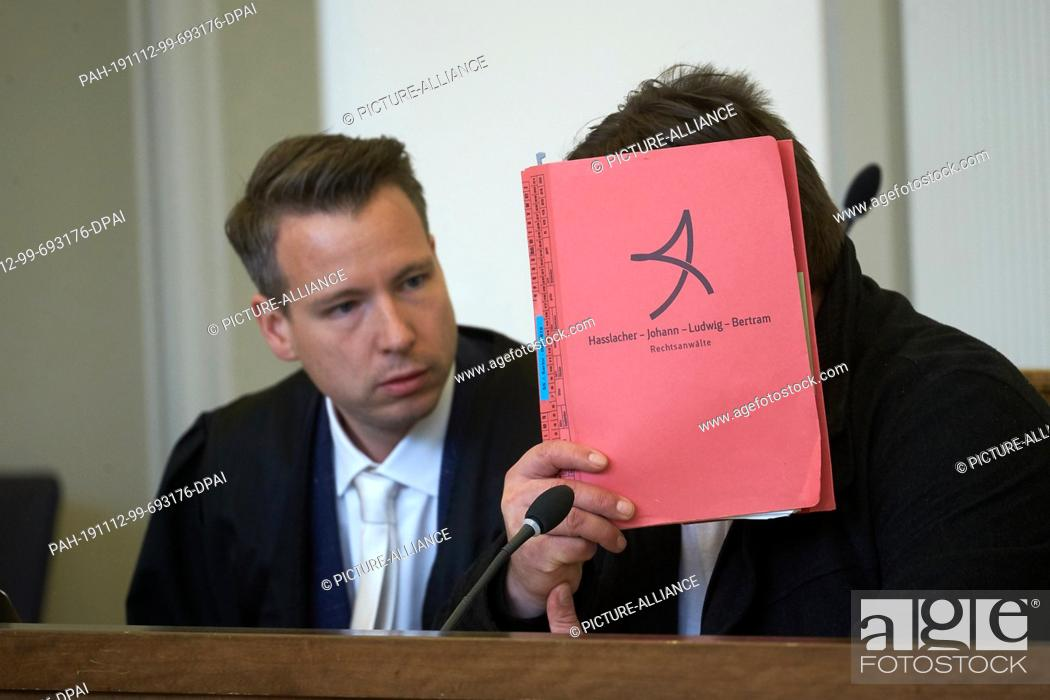 Stock Photo: 12 November 2019, Rhineland-Palatinate, Koblenz: The 46-year-old defendant (r) sits in the courtroom of the Regional Court next to his lawyer Axel Bertram.