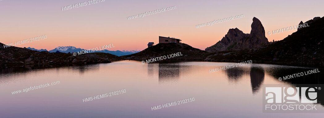 Stock Photo: France, Savoie, Beaufortain mountain, La Cote d'Aime, Lake Presset and refuge of Presset (2514m) overlooking Pierra Menta (2714m).