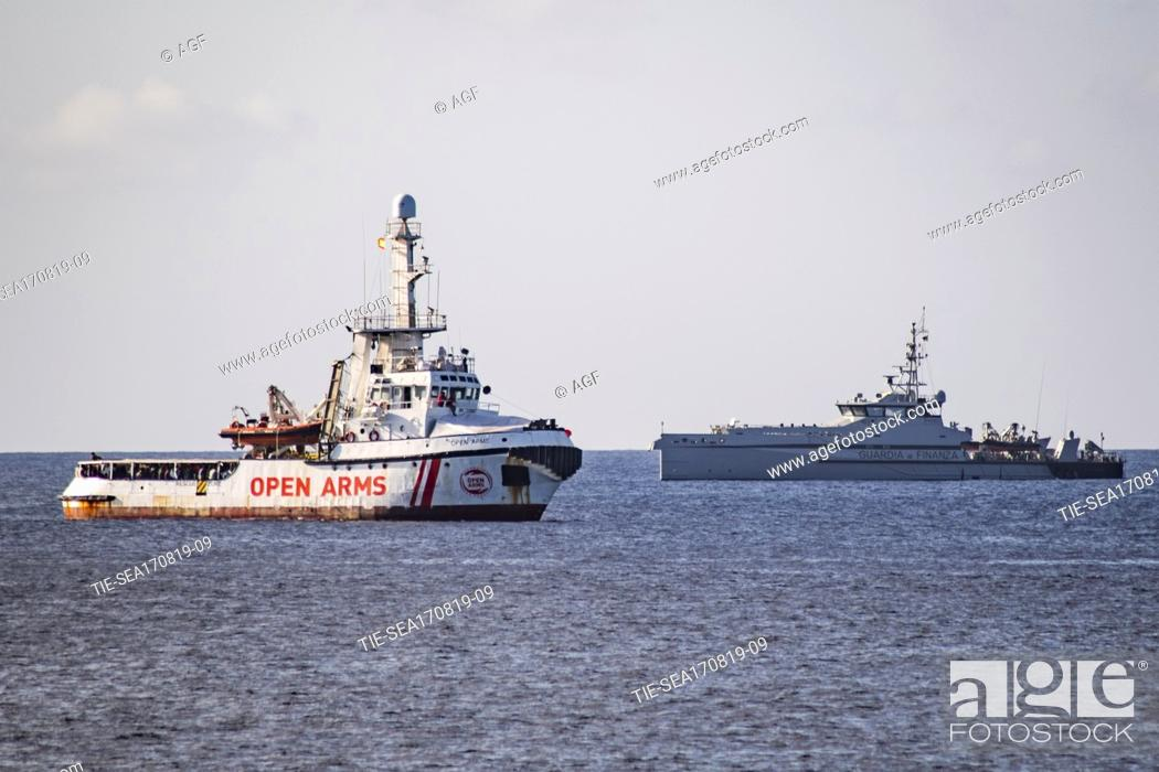 Stock Photo: A view of Spanish humanitarian ship Open Arms, with 147 migrants on board, in the immediate vicinity of Lampedusa, southern Italy, 17 August 2019.