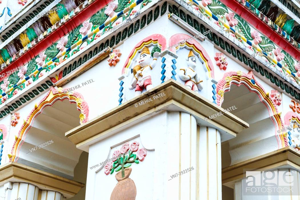 Stock Photo: Detail on the exterior walls of the main temple of Maheshwarnath Mandir, Triolet, Mauritius. Maheshwarnath Mandir or Temple as it is also known is oldest and.