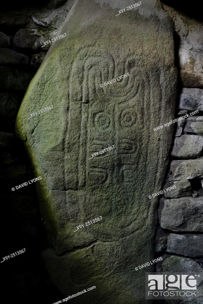 Stock Photo: Les Pierres Plates prehistoric Neolithic passage grave. Locmariaquer, Brittany, France. One of the passageway carved stones.