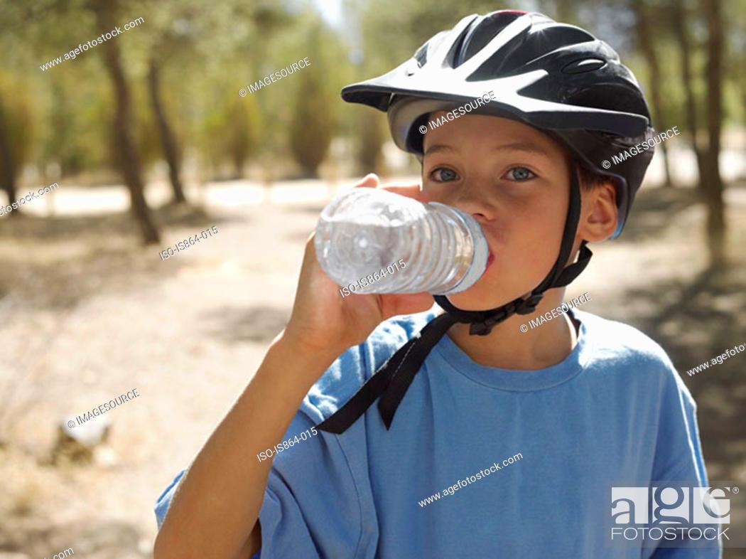 Stock Photo: Boy drinking water.