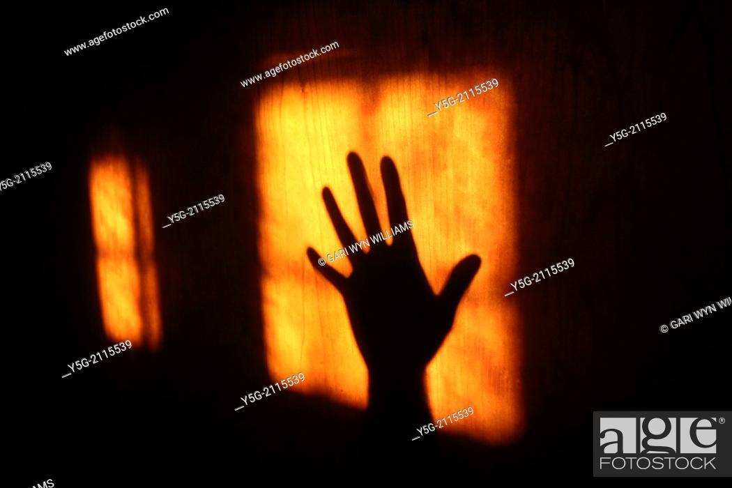 Stock Photo: hand shadow on wooden door.