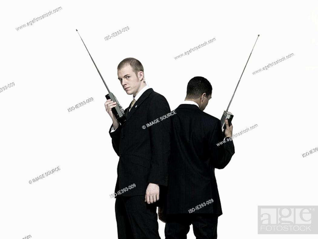 Stock Photo: Men with walkie talkies.