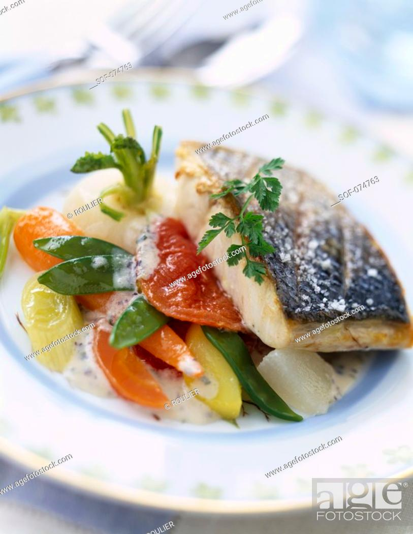 Stock Photo: grilled piece of bass with granulated salt and young vegetables.