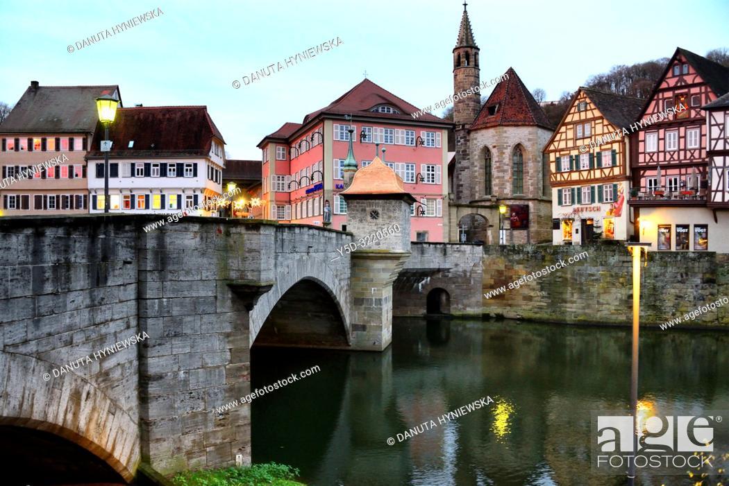 Stock Photo: Henkerbrucke - Henker bridge over Kocher river, traditional historic half-timbered townhouses and church Johanniterkirche in background.