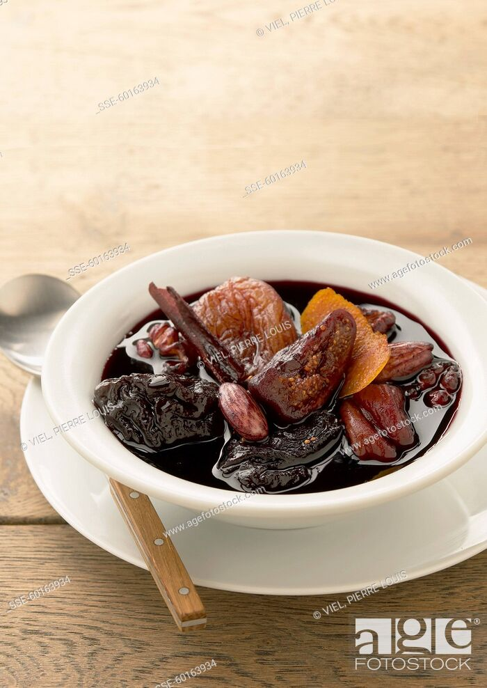 Stock Photo: Dried fruit stewed in red wine with cinnamon.