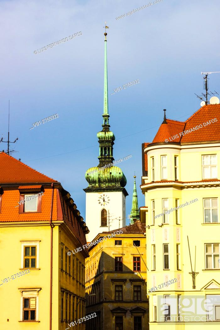 Imagen: St James church clock tower and surrounding buildings in after storm sun light. Brno, Czech Republic.