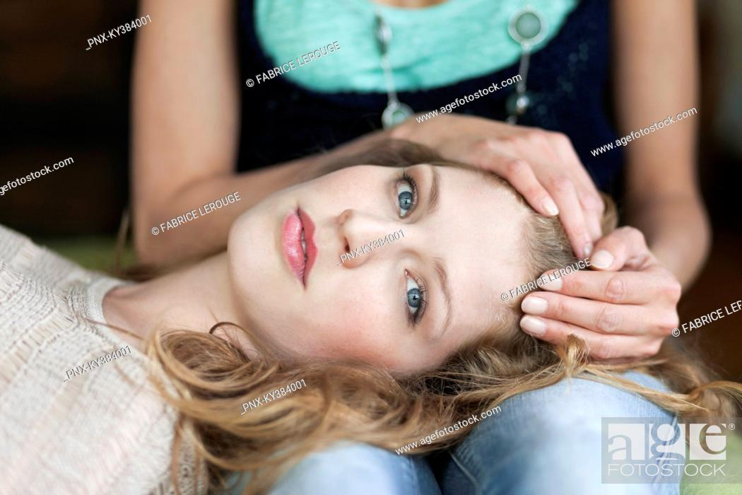 Stock Photo: Woman lying on her mother's lap.