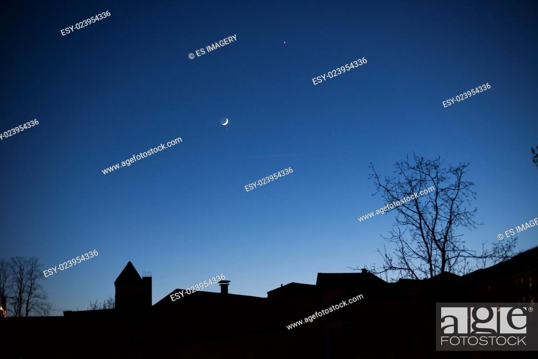 Stock Photo: Skyline of houses silhouetted at night, Frankfurt (Oder), Germany.