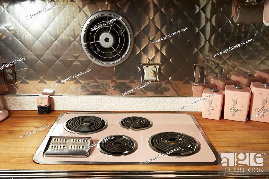Photo de stock: Vintage stove-top in a retro style kitchen.