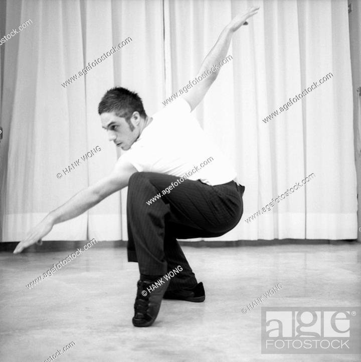 Stock Photo: Male dancer practicing in a studio.