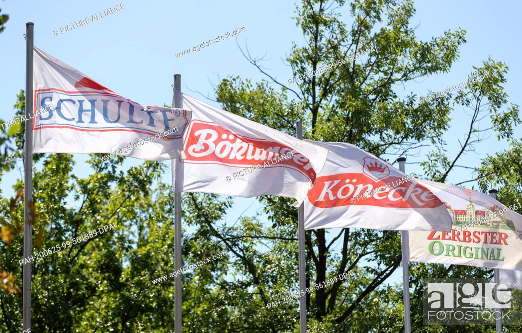 Stock Photo: 25 June 2020, Lower Saxony, Dissen: Flags of the companies Schulte, Böklunder, Könecke and Zerbster Original, which belong to the Tönnies Group.