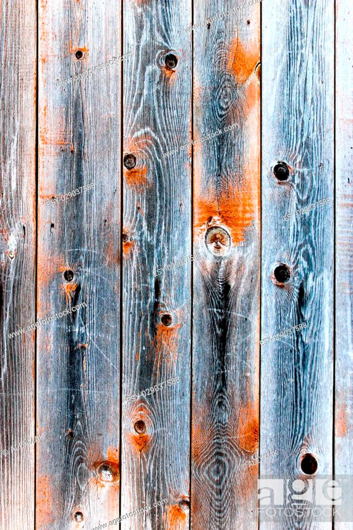 Photo de stock: Wooden fence of smoky color with knots.