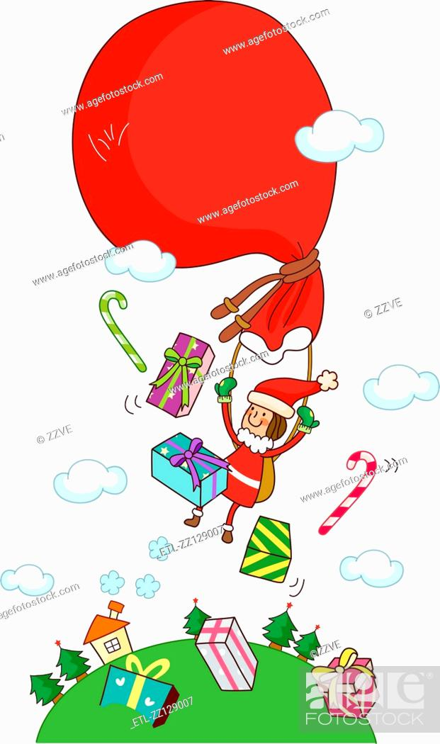 Stock Photo: Girl in a Santa costume flying with a gift bag.