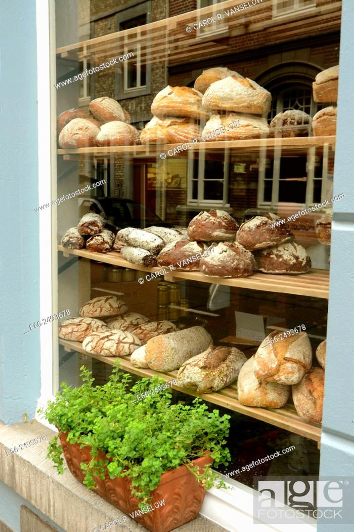 Stock Photo: Window of artinasal bakery shop in Maastricht, Limburg, the Netherlands. Here, in addition to bread you can buy locally made cheeses, hand made lemon curd.
