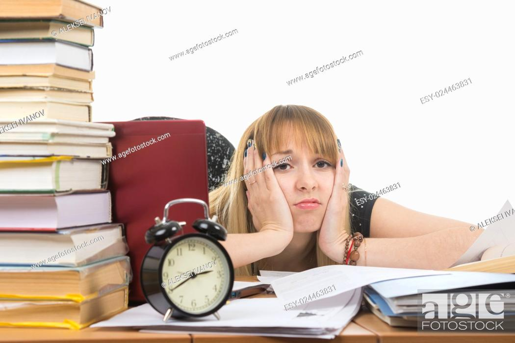 Stock Photo: Student bored and tired of doing the preparation for exams.