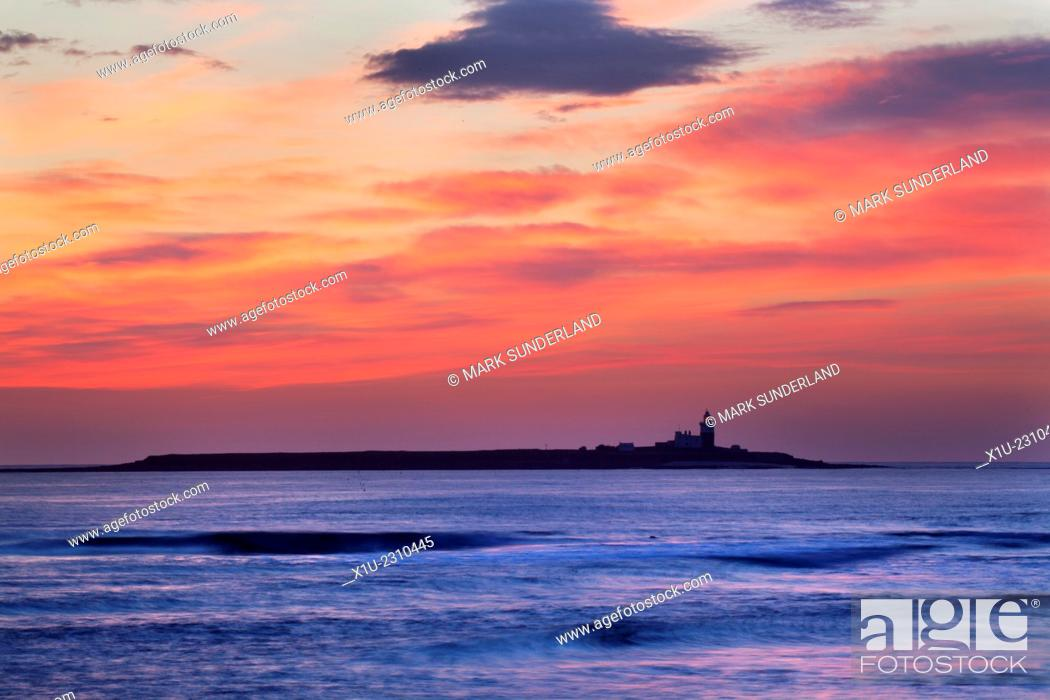 Stock Photo: Dawn Sky over Coquet Island Amble by the Sea Northumberland England.