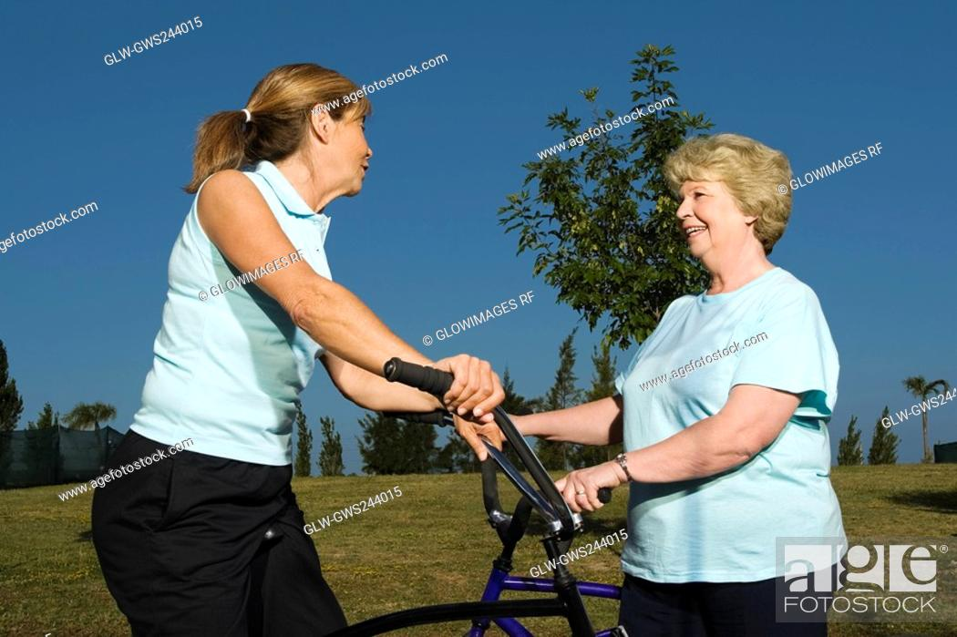 Stock Photo: Side profile of two senior women talking to each other.
