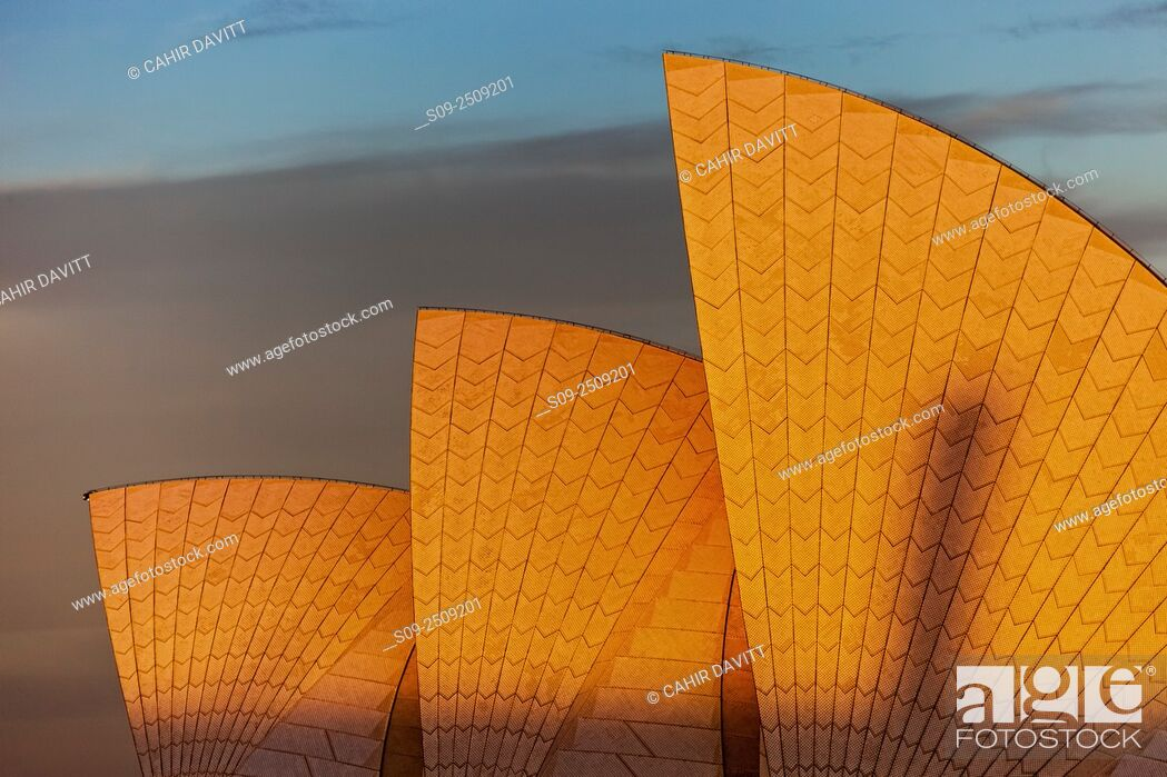 Stock Photo: The sails of the Sydney Opera House, Designed by the Architect Jorn Utzorn glow in the light of the setting sun, Bennelong Point, viewed from the Rocks, Sydney.