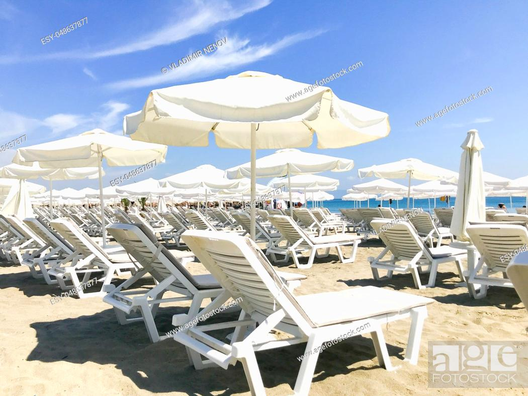 Stock Photo: White Loungers And Umbrellas At The Beach In Pomorie, Bulgaria.