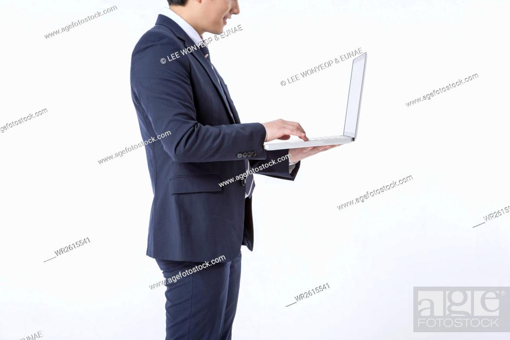 Stock Photo: Businessman using a.notebook computer.