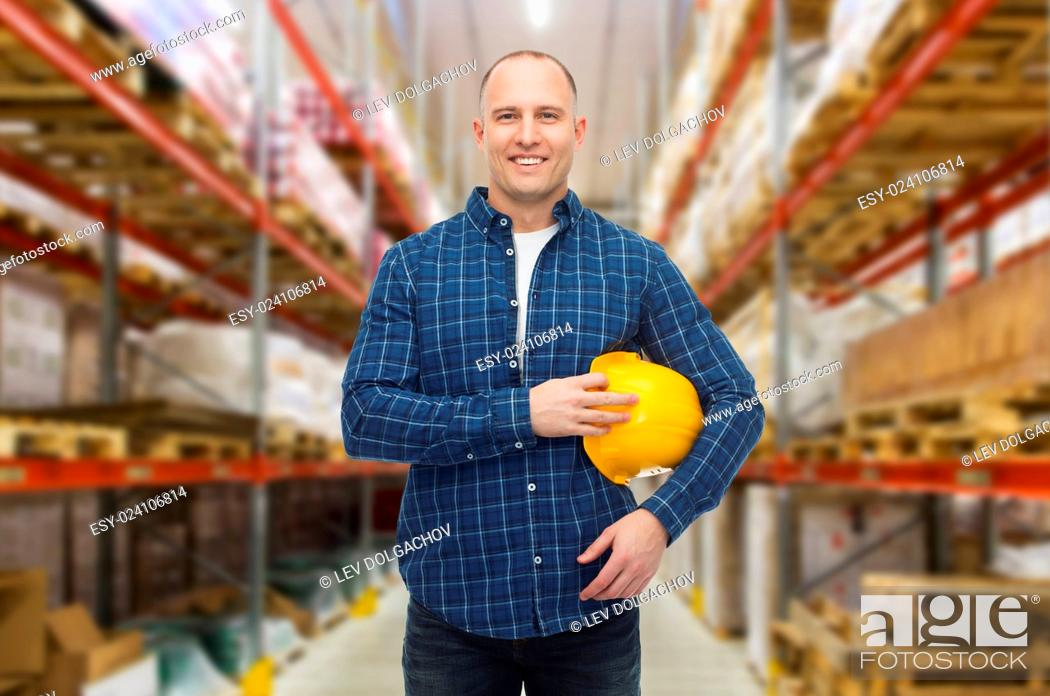 Stock Photo: storage, shipment, logistic business, people and export concept - happy man with hardhat over warehouse background.