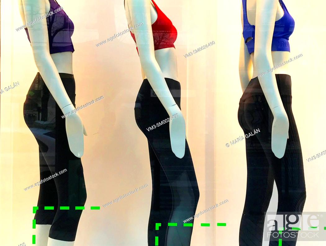 Stock Photo: Three mannequins in a shop window wearing fitness clothes. Madrid, Spain.