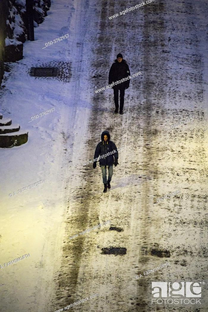 Stock Photo: Stockholm, Sweden Pedestrians on Brannkyrkagatan in the snow in the early morning.