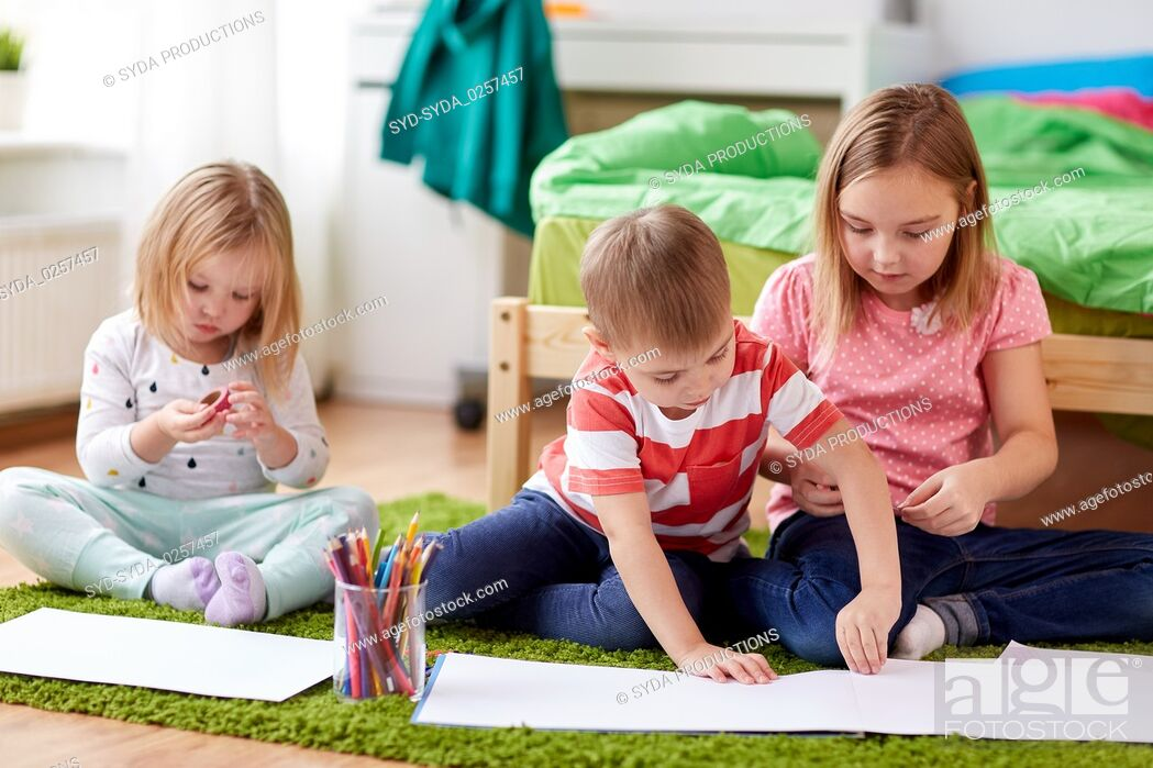Stock Photo: happy creative kids making crafts at home.