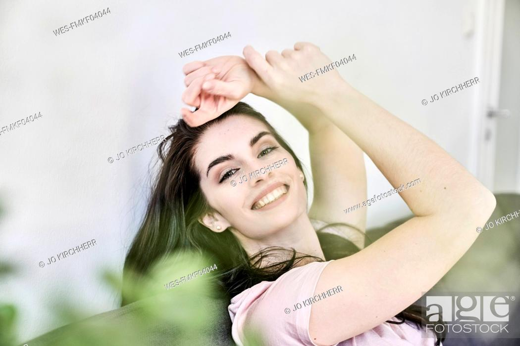 Stock Photo: Portrait of smiling young woman at home.