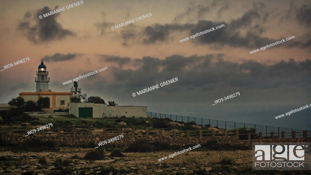 Stock Photo: Mesa Roldan's lighthouse at sunset with grain vintage analog look, Carboneras, Almeria, Spain.