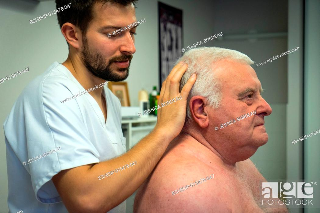 Stock Photo: Osteopathy session for a 69-year old man suffering from pain in the lumbar belt and the shoulder girdle.
