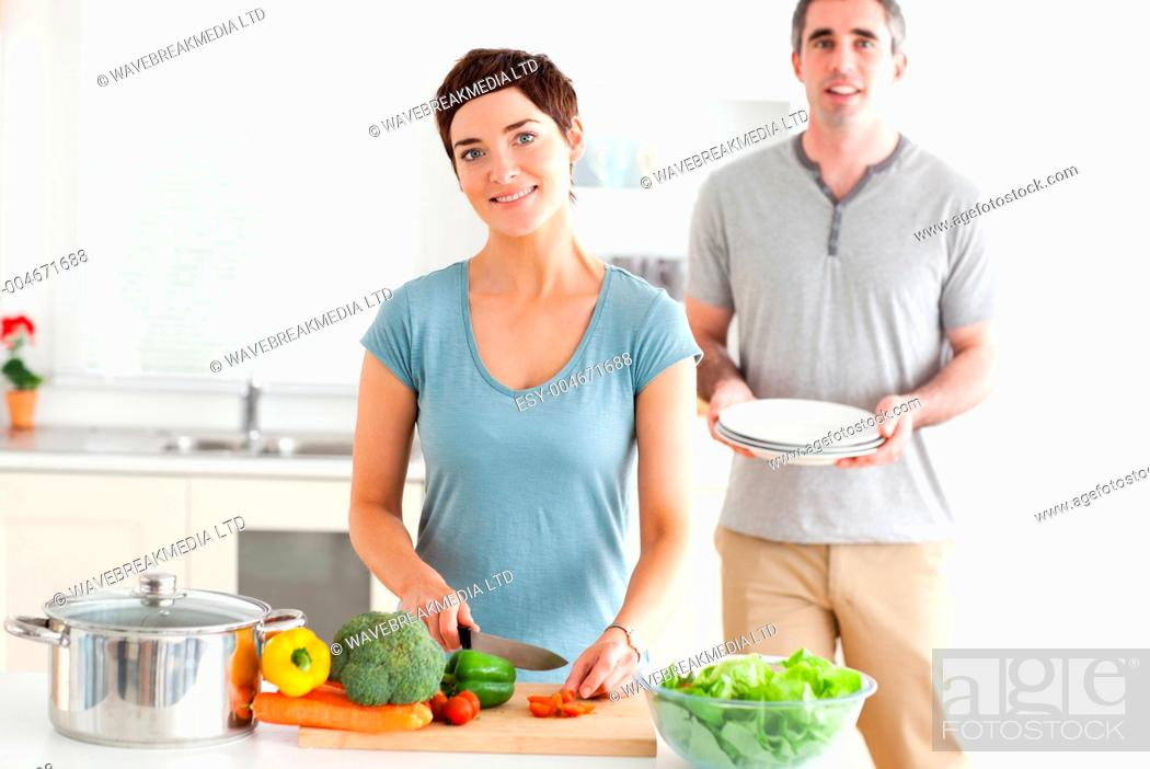 Stock Photo: Smiling Couple preparing lunch.