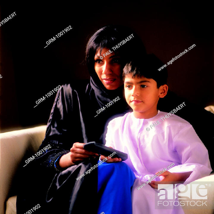 Stock Photo: Arab mother and young boy watching TV.