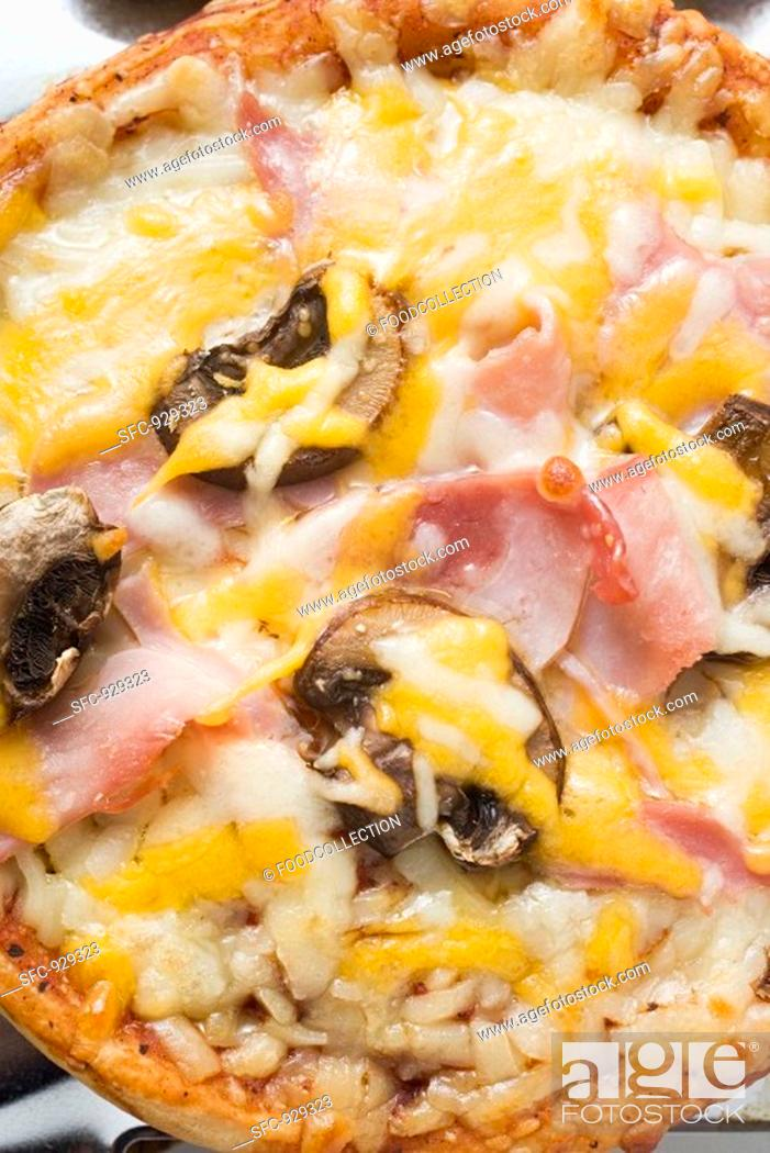 Stock Photo: Mini-pizza with ham, mushrooms and cheese.