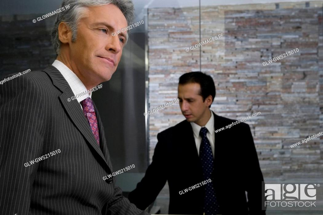 Stock Photo: Side profile of a mature man standing at the reception.